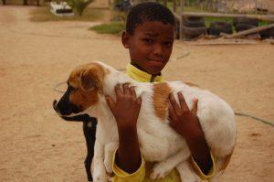 boy holding his dog close