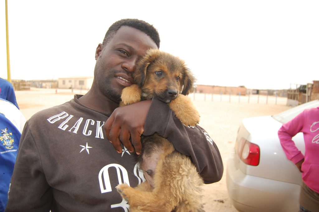 man with fluffy puppy