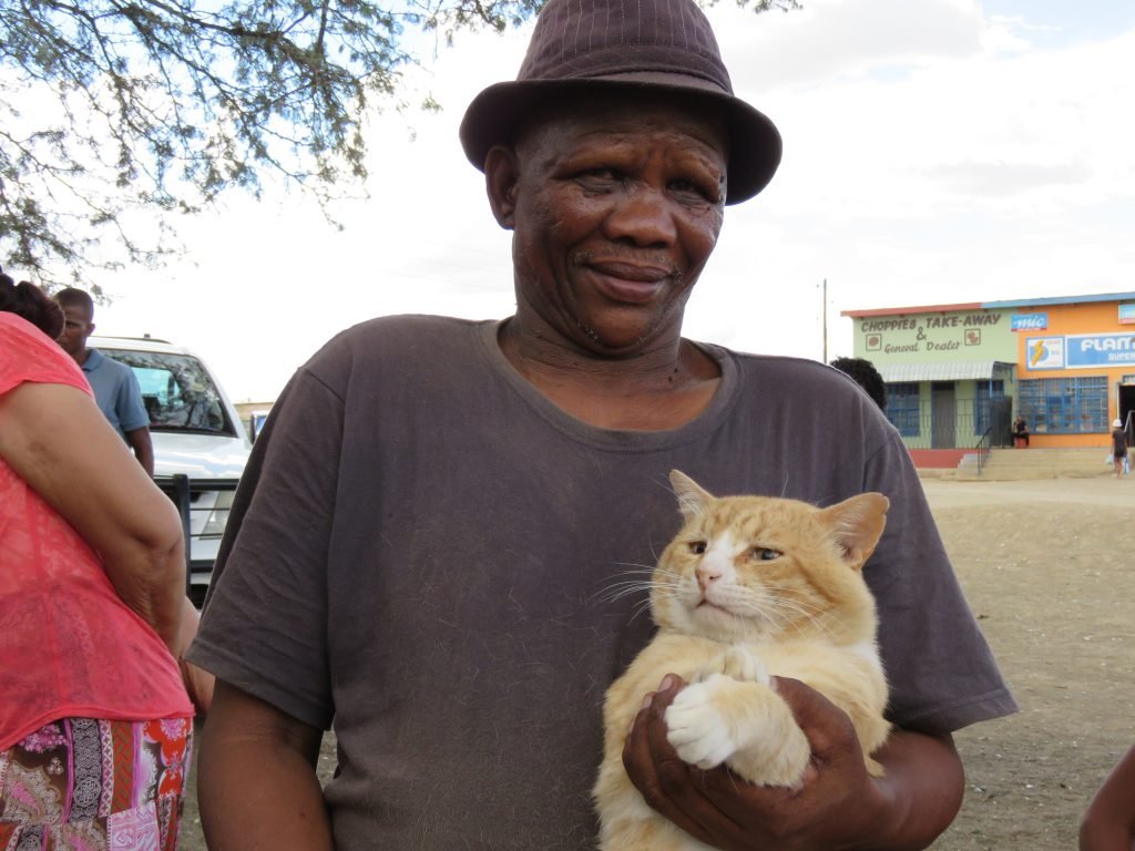 man and his beautiful big tom cat