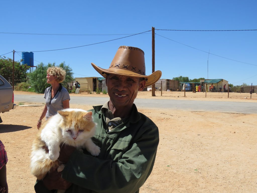 big cat with his proud owner in aus