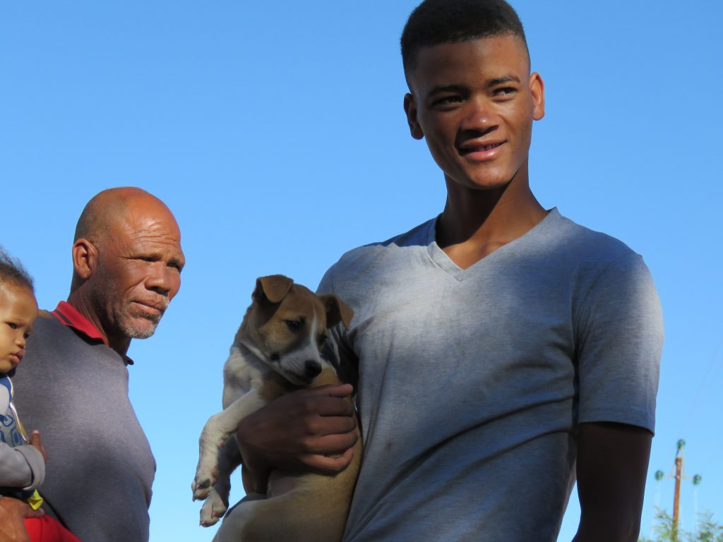 young man and puppy