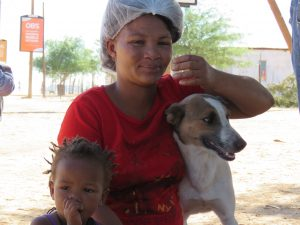 young woman with small child and dog