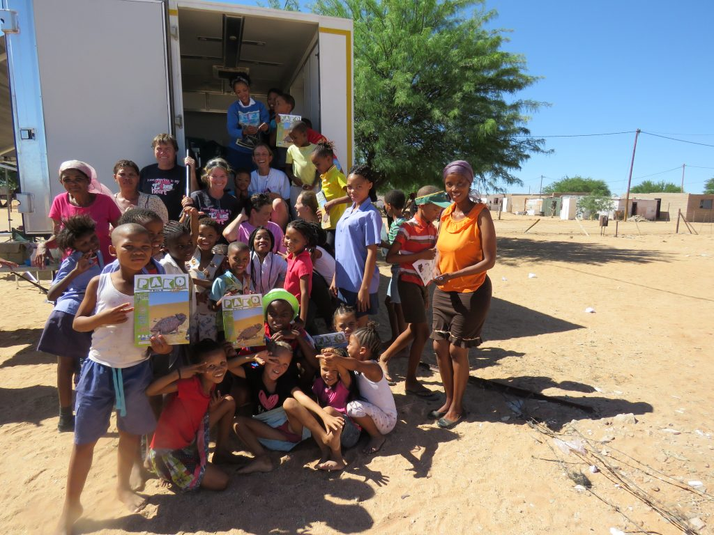 children in front of the mobile clinic
