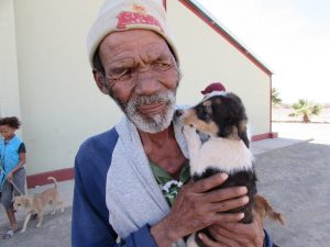 old man from bethanie with his puppy